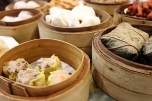 different types of dim-sum steaming in a basket