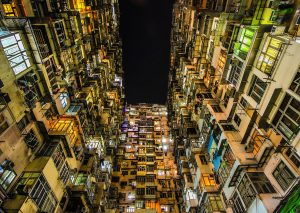 crammed apartments with lights on in Hong Kong