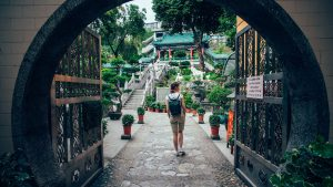 A backpacker exploring a temple in Hong Kong