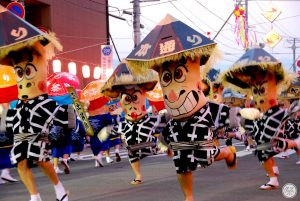 Japanese festival with people dressed in colorful outifts