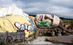 A large broken, abandoned statue of Gulliver from Gullivers travels in Kawaguchi, Japan