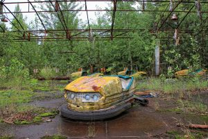 Broken down bumper cars with rubbish and a gloomy sky