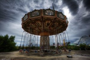 An abandoned ferris wheel with a gloomy background, six flags theme park
