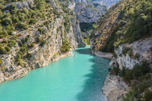 A crystal clear lake with surrounding mountains in france