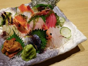 A plate of colourful sliced sashimi including unagi