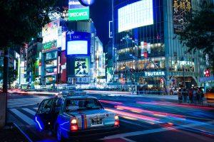 Shibuya crossing in Tokyo with Neon lights