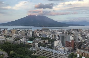 Mount-Sakurajima-view-at-sunset-from-the-shiroyama-hotel-featuring-city-view-and-dusk-clouds