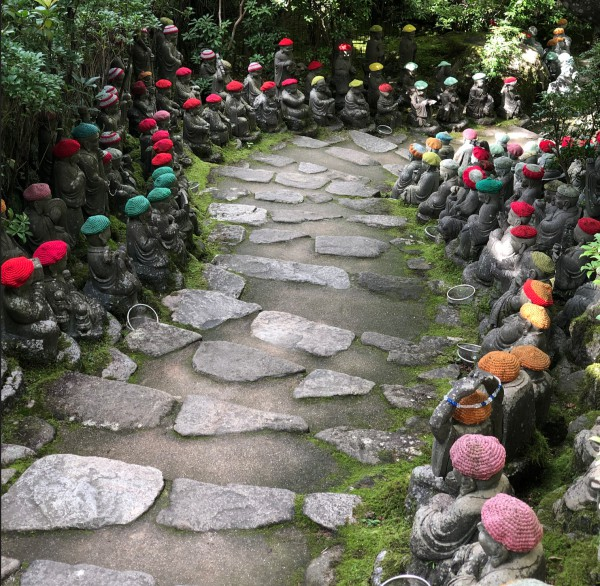 daisho-in-temple-pathway-lined-with-colourful-hat-wearing-buddhist-staues