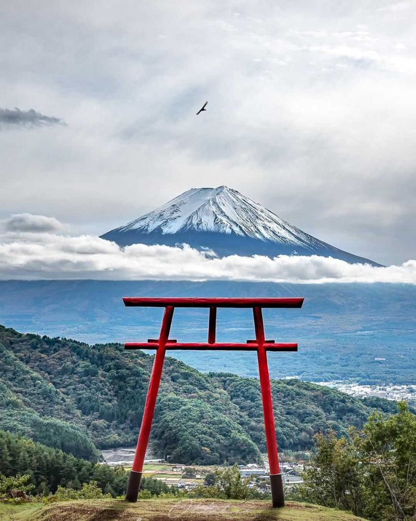 Huge mountain with a red tori gate